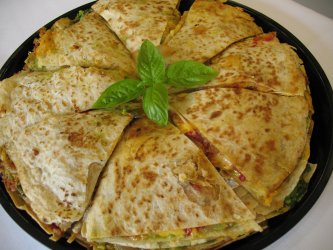 Individual vegetable quesadillas served with salsa or guacamole